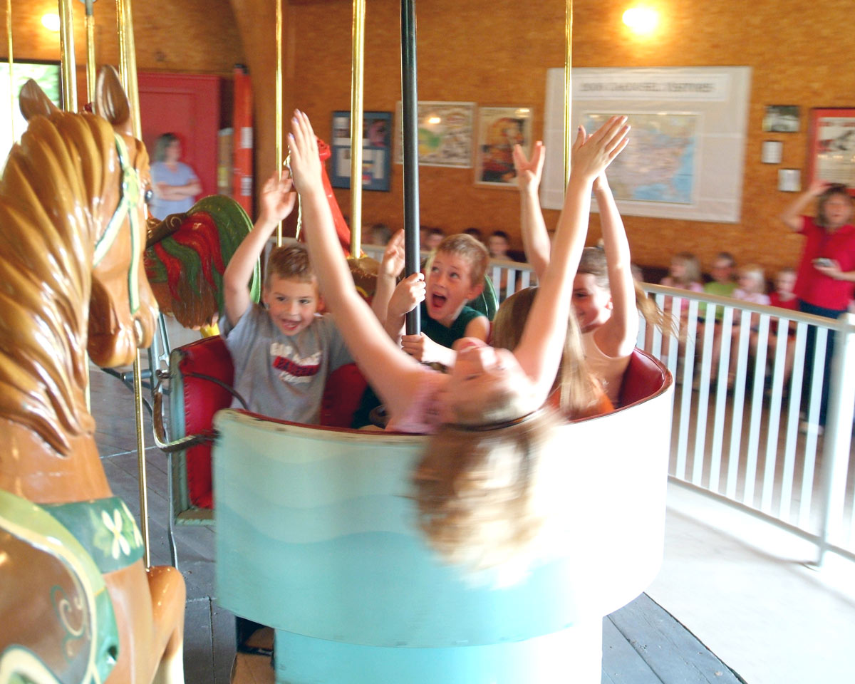 Story City Kids on carousel in motion